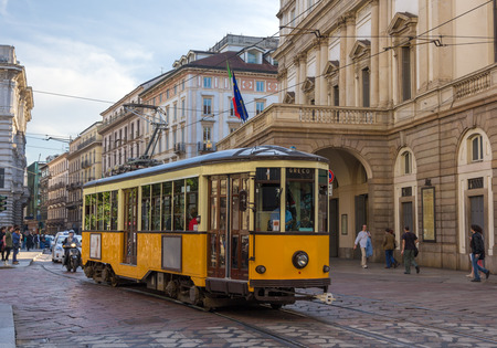 Old tram passing at La Scala theatre in Milan Editorial