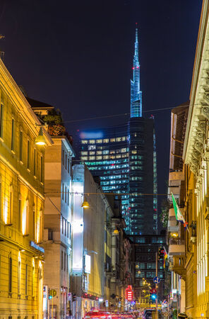 A street in Milan city center leading to the business district photo