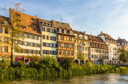 Traditional Alsatian buildings over the Ill river in Strasbourg photo