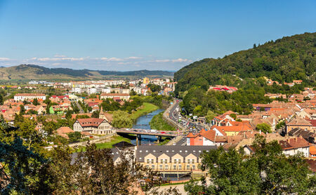 View of Sighisoara over the Tarnava river - Romania photo