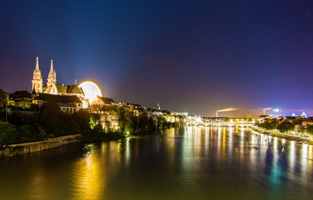 View of Basel over the Rhine by night - Switzerland Stock Photo