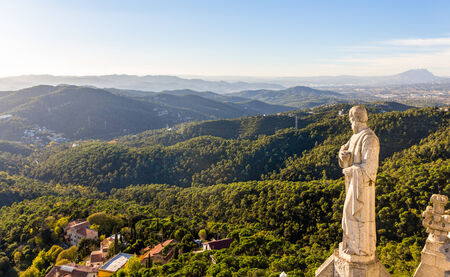 sagrat cor: Sculpture of Apostle and mountains near Barcelona Stock Photo