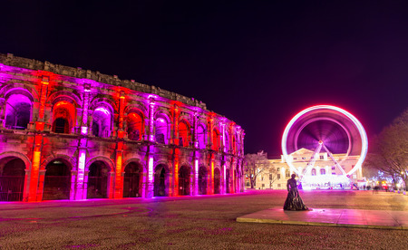 Roman amphitheatre, Arena of Nimes, in the evening - France