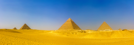 View of pyramids in Giza: Queens' Pyramids, the Pyramid of Menkaure, the Pyramid of Khafre and the Great Pyramid of Giza (Khufu or Cheops)