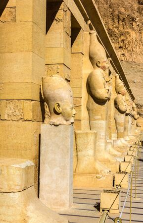 mortuary: Ancient statues in the Mortuary temple of Hatshepsut - Egypt Stock Photo