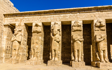 3rd ancient: Ancient figures in the Medinet Habu temple - Egypt Stock Photo
