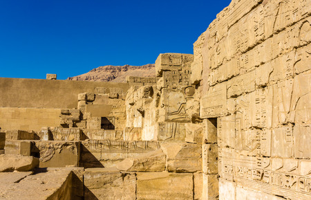 mortuary: Ancient carvings in the Mortuary Temple of Ramses III. near Luxor - Egypt Stock Photo