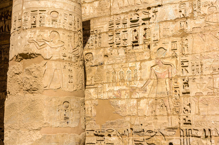3rd ancient: Ancient carvings in the Mortuary Temple of Ramses III. near Luxor - Egypt Stock Photo