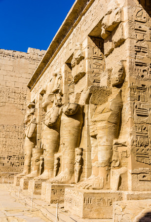 mortuary: Ancient egyptian statues in the mortuary Temple of Ramses III