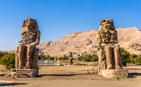 thebes: Colossi of Memnon (statues of Pharaoh Amenhotep III) near Luxor - Egypt