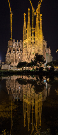 begun: BARCELONA, SPAIN - NOVEMBER 09: Night view of Sagrada Familia church on November 09, 2013 in Barcelona. Construction of the temple had begun in 1882 and to be finished in 2026