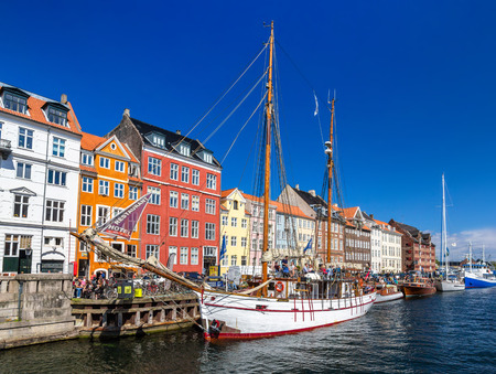 entertainment district: COPENHAGEN, DENMARK - MAY 29: Boats in Nyhavn on May 29, 2014 in Copenhagen, Denmark. Nyhavn is a 17th-century waterfront, canal and entertainment district Editorial
