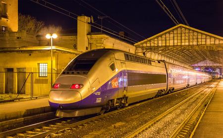 billion: BEZIERS, FRANCE - JANUARY 05: SNCF TGV Duplex train on Beziers station on January 5, 2014. TGV trains carried more than 2 billion passengers since startup