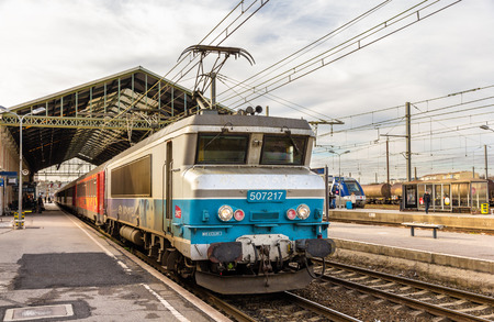 bb: NARBONNE, FRANCE - JANUARY 06: Passenger train hauled by electric locomotive at Narbonne station on January 6, 2014. SNCF operates 198 locomotive of the class BB 7200