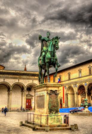 medici: Statue of Ferdinando I de Medici on Santissima Annunziata square in Florence - Italy Stock Photo