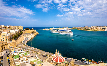 liner: Cruise liner leaving Valletta - Malta Stock Photo