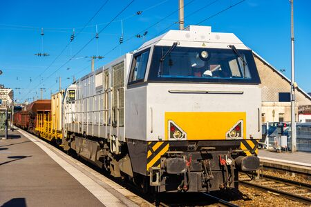 hauling: Diesel locomotive hauling a freight train at Besancon station - France