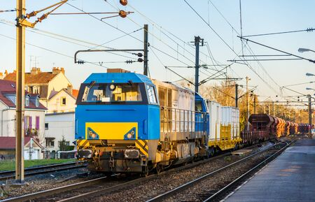 france station: Diesel locomotive hauling a freight train at Montbeliard station - France