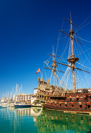 deck cannon: Sailing boat at the port of Genoa - Italy Stock Photo