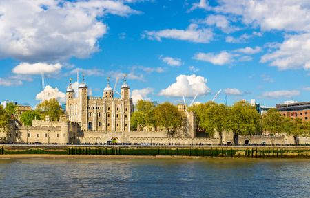 river stones: The Tower of London, a historic castle on a bank of the Thames Editorial