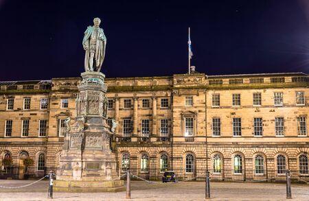 scott: Statue of Walter Montagu Douglas Scott in front of Parliament House in Edinburgh Editorial