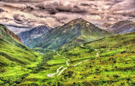 serpentine: Serpentine road between France, Andorra and Spain in the Pyrenees Stock Photo