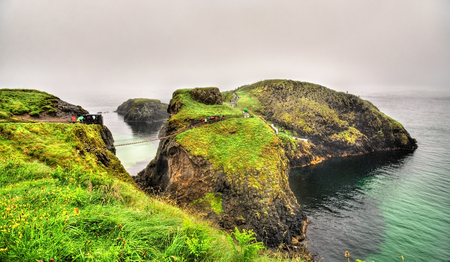 northern ireland: View of Carrick Island with Carrick-a-Rede Rope Bridge - Northern Ireland
