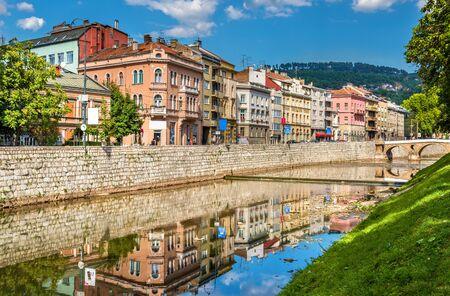 sarajevo: Buildings in Sarajevo over the river Miljacka - Bosnia and Herzegovina Stock Photo