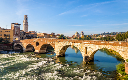 italy culture: Ponte Pietra (Stone Bridge) in Verona - Italy Stock Photo