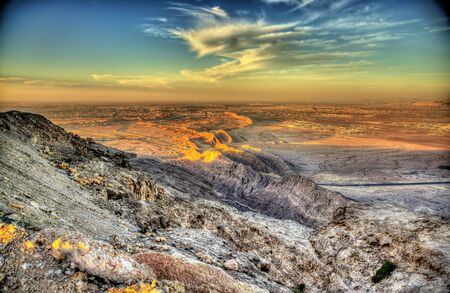valley view: View from Jebel Hafeet mountain towards Al Ain - UAE