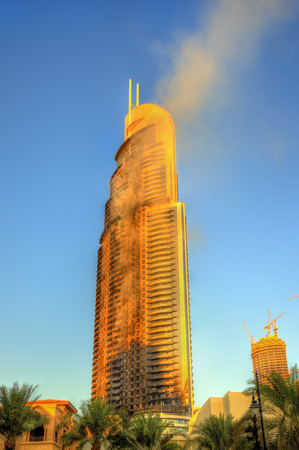 DUBAI, UAE - JANUARY 1: View of the Address Downtown Hotel on fire in Dubai on January 1, 2016. The tower caught fire on New Years Eve