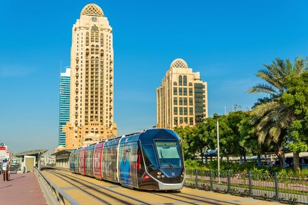 rta: DUBAI, UAE - DECEMBER 31: Alstom Citadis 402 tram on December 31, 2015 in Dubai, UAE. The only line with 11 stations was inaugurated on 11 November 2014 Editorial