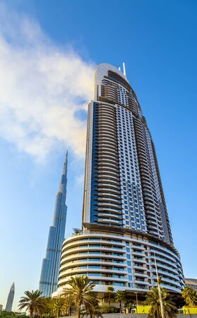 middle east fighting: DUBAI, UAE - JANUARY 1: View of the Address Downtown Hotel on fire in Dubai on January 1, 2016. The tower burned down on the New Years night