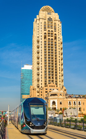 rta: DUBAI, UAE - DECEMBER 31: Alstom Citadis 402 tram on December 31, 2015 in Dubai, UAE. The system is wireless as it uses a ground-level power supply
