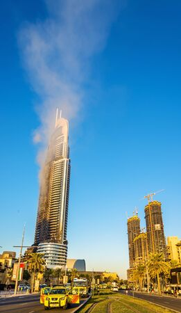 january 1: DUBAI, UAE - JANUARY 1: View of the Address Downtown Hotel on fire in Dubai on January 1, 2016. The tower burned down on the New Years night