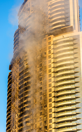 middle east fighting: A hotel on fire on January 1st, 2016 - Dubai Editorial