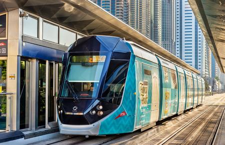 december 31: DUBAI, UAE - DECEMBER 31: Alstom Citadis 402 tram on December 31, 2015 in Dubai, UAE. The system is wireless as it uses a ground-level power supply