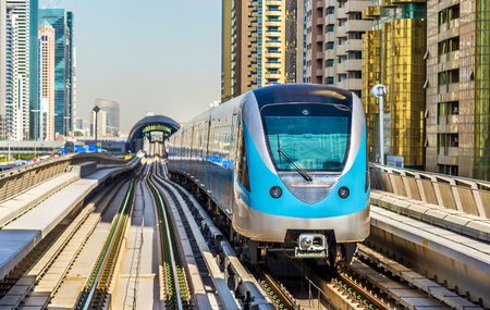 railroad transportation: Metro train on the Red line in Dubai Editorial