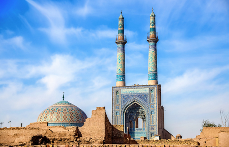 minarets: Jame Mosque of Yazd in Iran. The mosque is crowned by a pair of minarets, the highest in Iran. Stock Photo