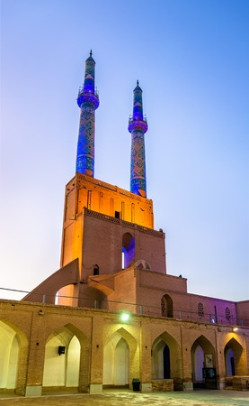 islamic scenery: Jame Mosque of Yazd in Iran. The mosque is crowned by a pair of minarets, the highest in Iran. Stock Photo