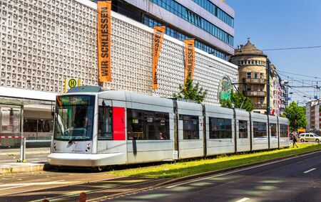 Dusseldorf, Germany - June 10, 2014: Siemens Combino tram in the city centre of Dusseldorf. The tramway network is operated by Rheinbahn AG and has 11 tram lines ran over 78 km of routes Editorial