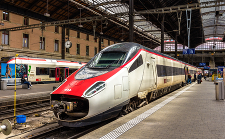 tilting: Basel, Switzerland - May 8, 2014: New Pendolino high-speed tilting train at Basel railway station. This train is owned by SBB CFF FFS - Swiss Federal Railways Editorial