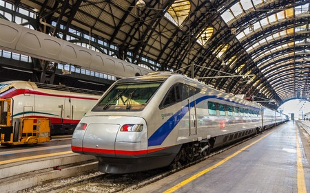 tilting: Milan, Italy - May 8, 2014: Pendolino high-speed tilting train at Milano Centrale railway station. This train is owned by SBB CFF FFS - Swiss Federal Railways