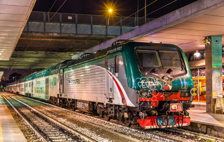 garibaldi: Milan, Italy - May 8, 2014: Class E.464 locomotive hauling a regional train at Milano Porta Garibaldi railway station. Trenord is a regional passenger company in Lombardy Editorial