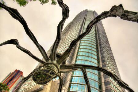 mori: Tokyo, Japan - May 10, 2016: Maman, a spider sculpture, and Mori Tower in Roppongi Hills. Editorial