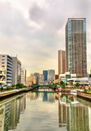 minato: Buildings and canal in Minato ward - Tokyo, Japan Stock Photo