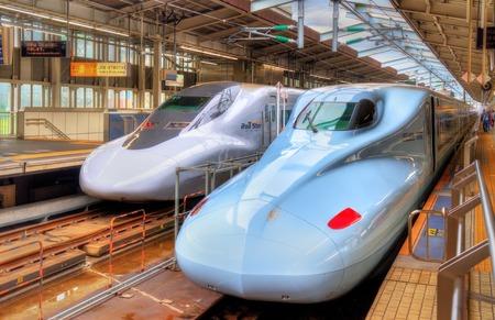 sanyo: Osaka, Japan - May 11, 2016: Shinkansen trains at Shin-Osaka Station. The station is the terminus of the high-speed Tokaido and Sanyo Shinkansen lines