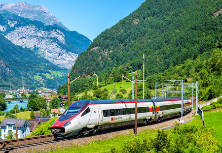 tilting: Erstfeld, Switzerland - July 30, 2016: Alstom ETR 610 tilting high-speed train on the Gotthard railway. The traffic will be diverted to the Gotthard Base Tunnel in December 2016.