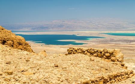 judean hills: Ruins of Masada fortress and Dead Sea - Israel Stock Photo