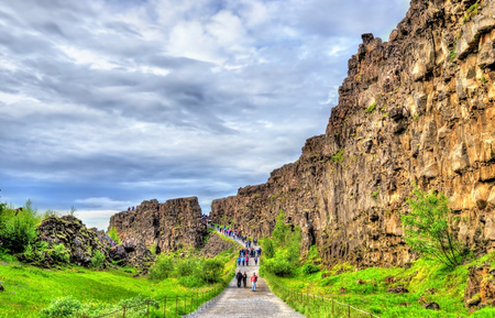 Road in a fissure between tectonic plates in the Thingvellir National Park, Iceland